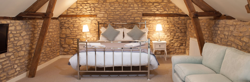 a bed in the guest room at The Bell Inn